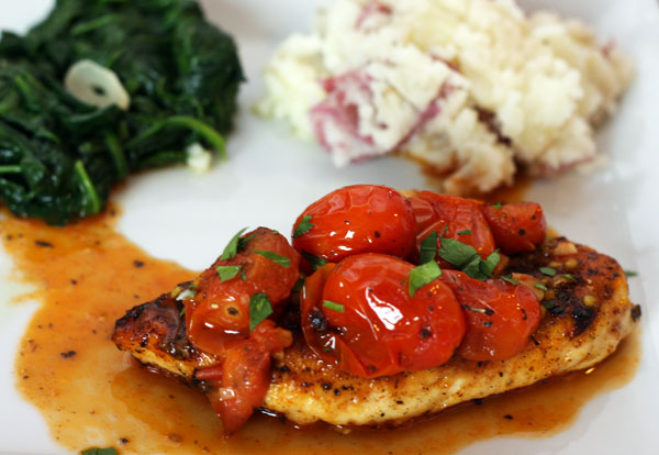 Chicken with Tomato Herb Pan Sauce a flavorful and delicious dinner.