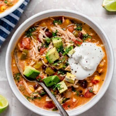 Slow cooker chicken enchilada soup is full of flavor and the perfect weeknight meal that takes no time at all to put together!