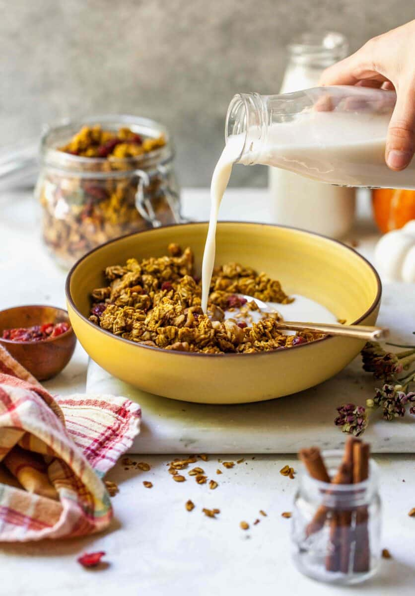 Pumpkin cranberry granola is a deliciously simple yet aromatic Fall treat! You'll want to eat it with almost everything!