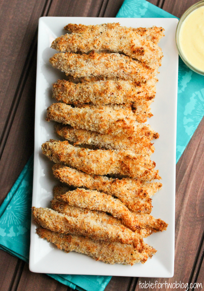 Oven-baked chicken fingers are much better than frying chicken tenders! Give these a try and see how easy making oven-baked chicken tenders can be! Jus as delicious with a great dipping sauce!