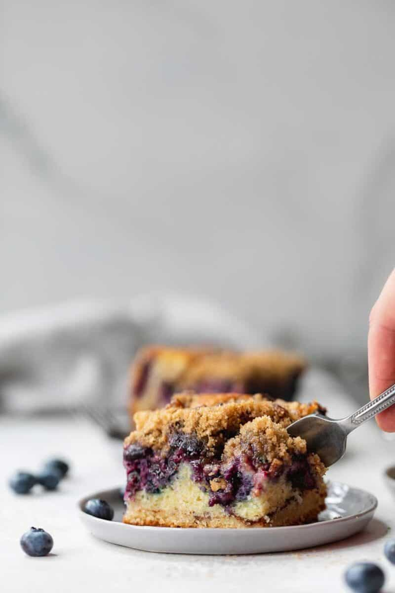 This blueberry coffee cake is tender, moist, and bursting with fresh summer blueberries! The perfect pairing with your coffee or afternoon tea!
