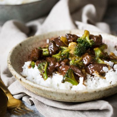 Slow cooker beef and broccoli is easy to make at home and such a warm comforting meal to have in a big bowl of rice! Much better than calling take-out; simply whip out your slow cooker and make this beef and broccoli at home!