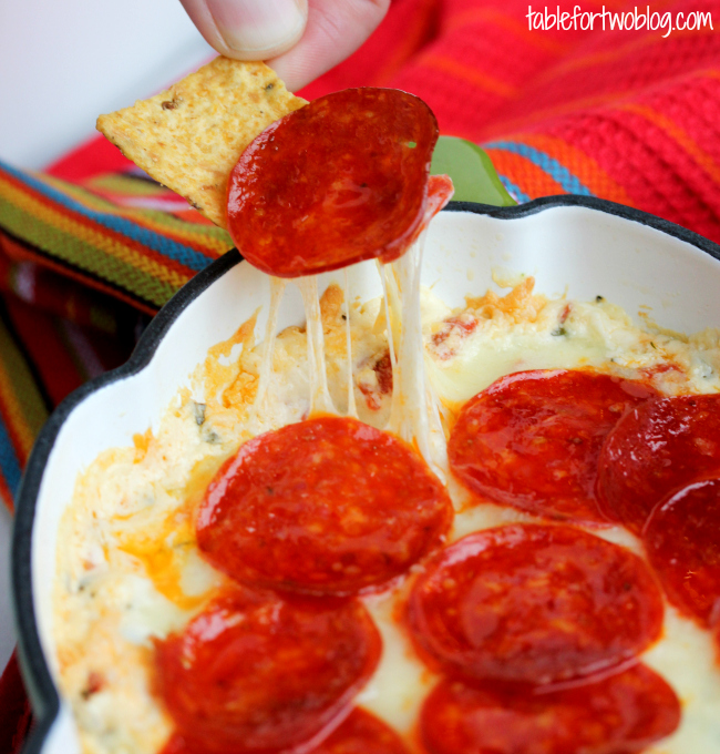Game day dip: pepperoni pizza dip from tablefortwoblog.com