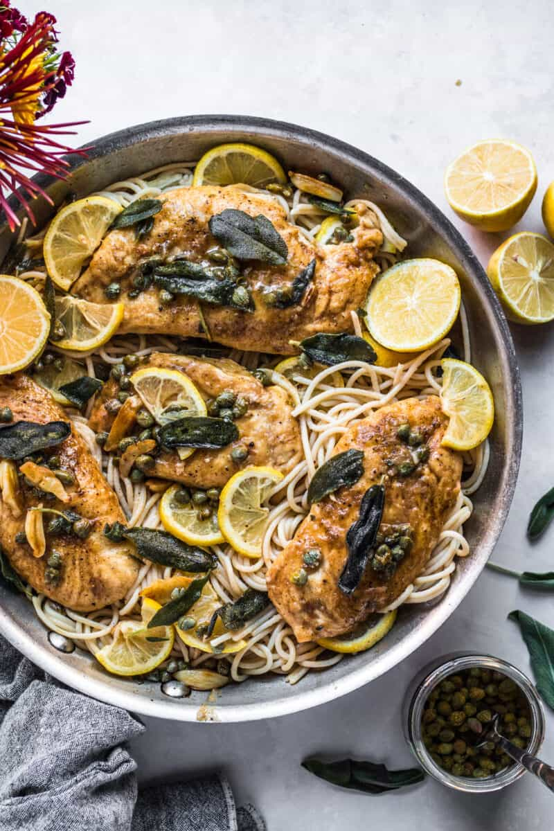 This easy chicken piccata is elevated with a crispy sage and garlic brown butter sauce! Still, it only takes less than an hour to put this gorgeous dish together for dinner!