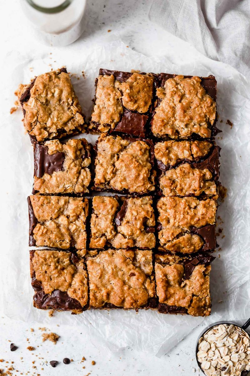 These oatmeal and chocolate cookie bars are a result of an oatmeal cookie having a baby with a chocolate cookie. So freaking good!!