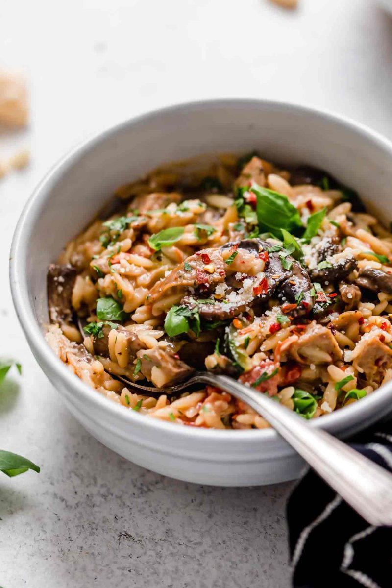 This one-pot creamy orzo with chicken sausage is a delightful dish that can be thrown together even on the busiest of weeknights! Use whatever you have in the fridge and you're sure to have a delicious meal at the end!