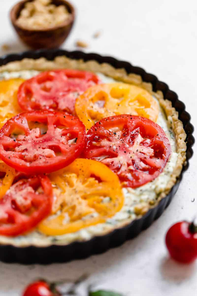 This gorgeous tomato ricotta tart uses up all your summer's freshest tomatoes! Just another way to eat up all of summer!