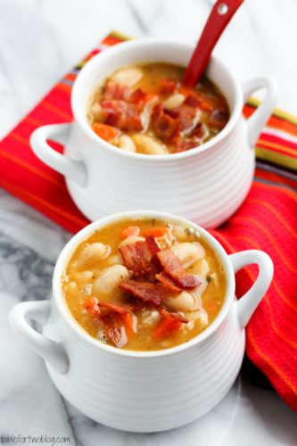 Creamy white bean and bacon soup will warm you right up! The flavors are INCREDIBLE - smokey, creamy, and so hearty!!