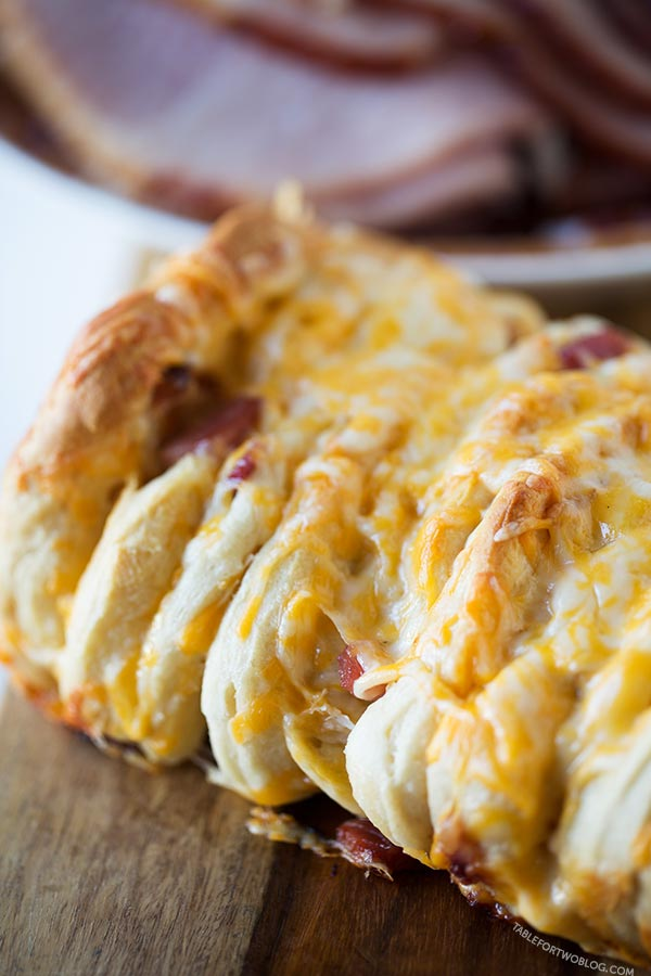 Ham and cheese pull apart bread is so easy to make for a crowd! Recipe on tablefortwoblog.com