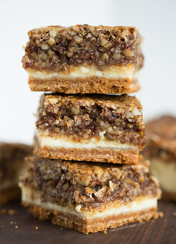 Hazelnut pecan cheesecake bars is a decadent treat perfect for sharing! Recipe on tablefortwoblog.com