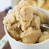 The moistest very vanilla mug cake is like a fluffy vanilla cupcake in a mug! Recipe on tablefortwoblog.com