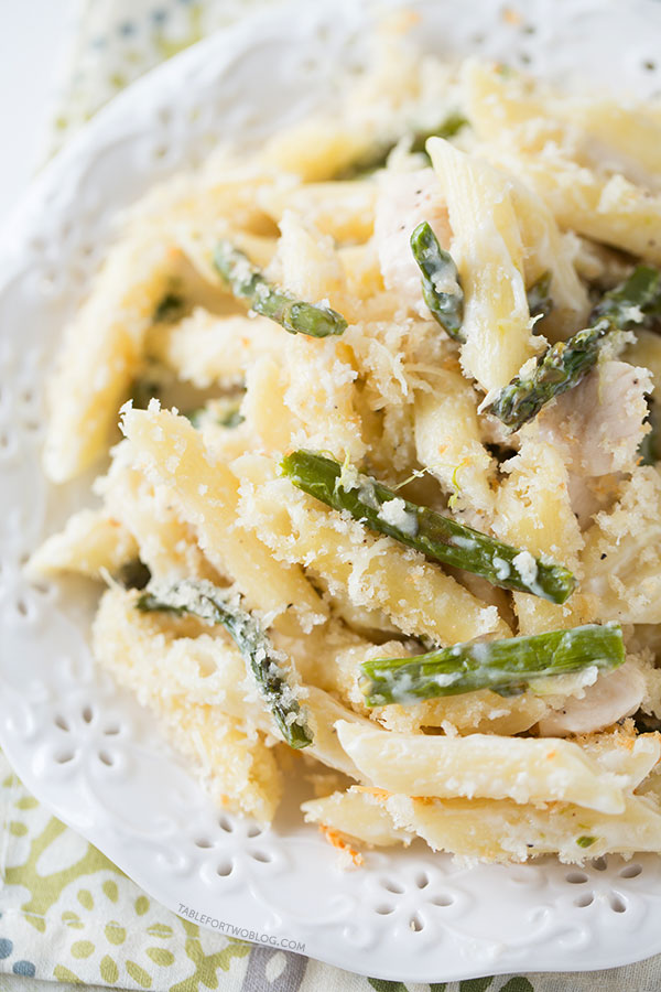 Roasted asparagus and chicken penne bake is a great way to use up the in-season asparagus! Recipe on tablefortwoblog.com