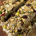 Make a batch of these cranberry pistachio granola bars to take as a snack to the beach, pool, or even plane ride for happy campers while traveling!