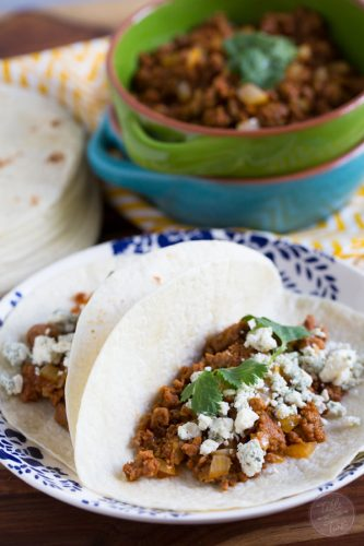 If you've never had blue cheese on tacos, you're missing out! It pairs perfectly with the spicy chorizo!