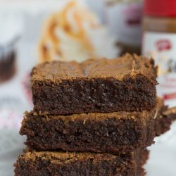 These fudgy Biscoff swirl brownies are the moistest and chewiest brownies ever! The Biscoff swirl on top gives this brownie that irresistible touch!