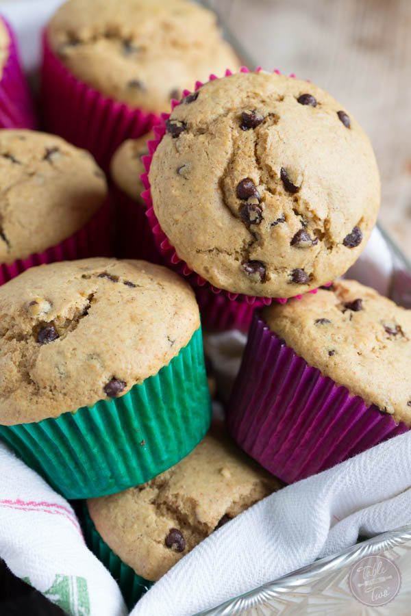 There's a secret to these fluffy whole wheat blend chocolate chip muffins! You're going to love these healthier muffins!