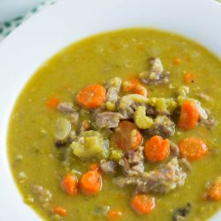 Traditional split pea soup has nothing on this slow cooker smokey ham and split pea soup! It's seriously got the most amazing smokey flavor and so easy to throw together!