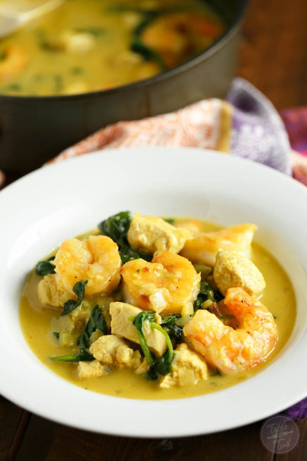 This garlic coconut curry shrimp bowl is bursting with rich flavor and paleo-friendly! You'll love the crispy exterior of the shrimp in the creamy and hearty soup!