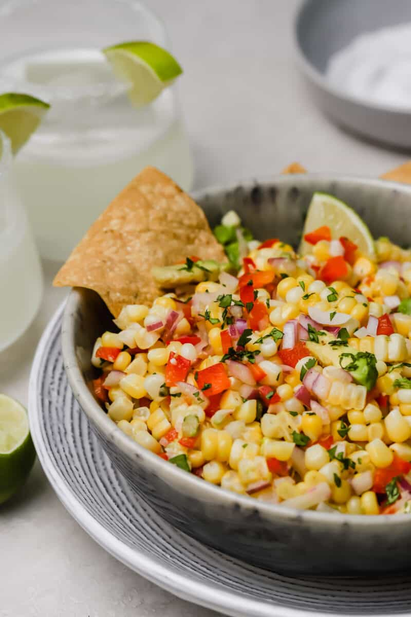 Corn and avocado salsa is an easy side dish to go with any dinner or grilling party! A great way to use up summer's sweetness.