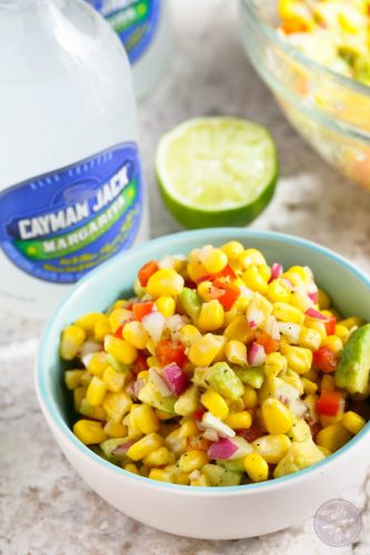Corn and avocado salsa paired with a refreshing drink or chips is the perfect combination for your next summer retreat with friends and family!