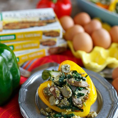 Stuffed breakfast peppers filled with sausage, spinach, mushrooms, and eggs are a fun new way to serve breakfast and eat it too! #sponsored