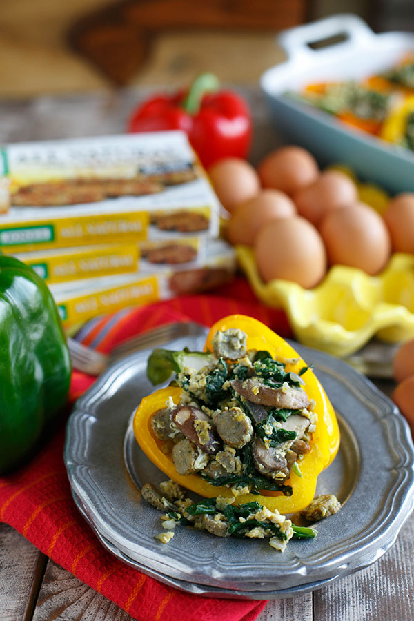 Stuffed breakfast peppers filled with sausage, spinach, mushrooms, and eggs are a fun new way to serve breakfast and eat it too!