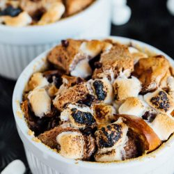 No campfire? No worries! This s'mores bread pudding for two made right in the oven is a great way to have an indoor campfire date night! Sweet tooth, required.