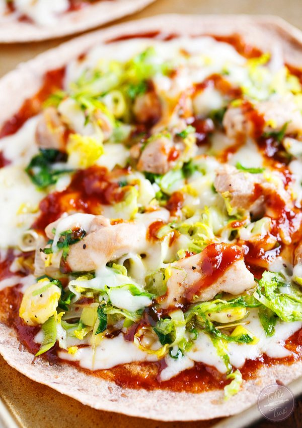 The flavors of this Sriracha BBQ Chicken, Leek, and Brussels Sprouts Pizza will have you coming back for more! Made even easier with soft flour tortillas instead of pizza dough!