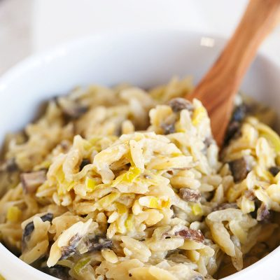 This leek and mushroom orzo dish is incredibly creamy and irresistible thanks to Boursin cheese! You will LOVE it and it comes together in 30 minutes!