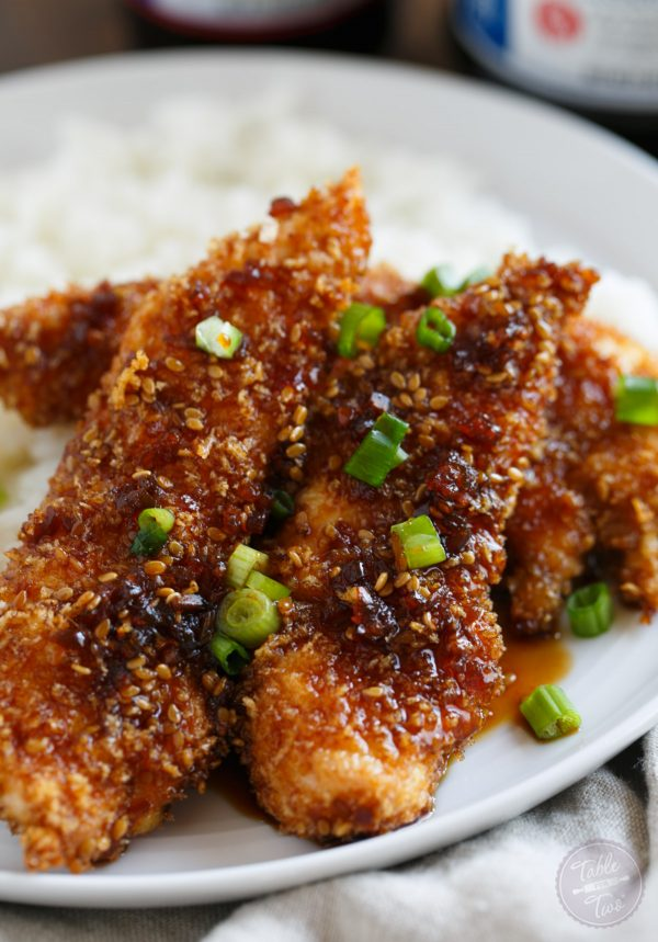Crispy Sweet and Spicy Chicken Tenders placed on top of rice is delicious way to spice up your weeknight dinner with @soyvay! #teamrice all the way! #UnlocktheAwesome #sponsored