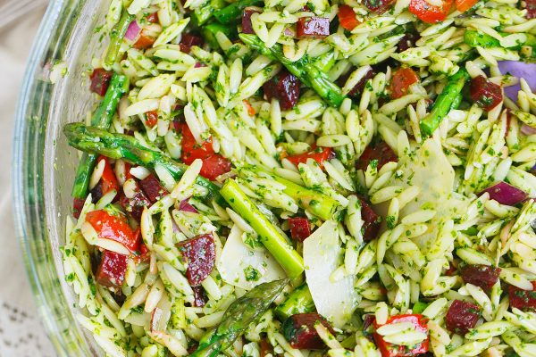 A great springtime pasta salad dish to bring to outdoor events or to have at home! The flavors and colors of this dish will make any day cheery!