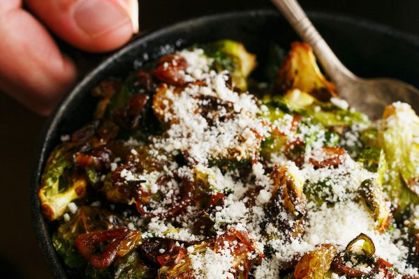 A new side dish for you to try! Roasted brussels sprouts tossed with caramelized shallots and golden raisins topped with salty cotija cheese. You will LOVE this new addition to your dinner table!