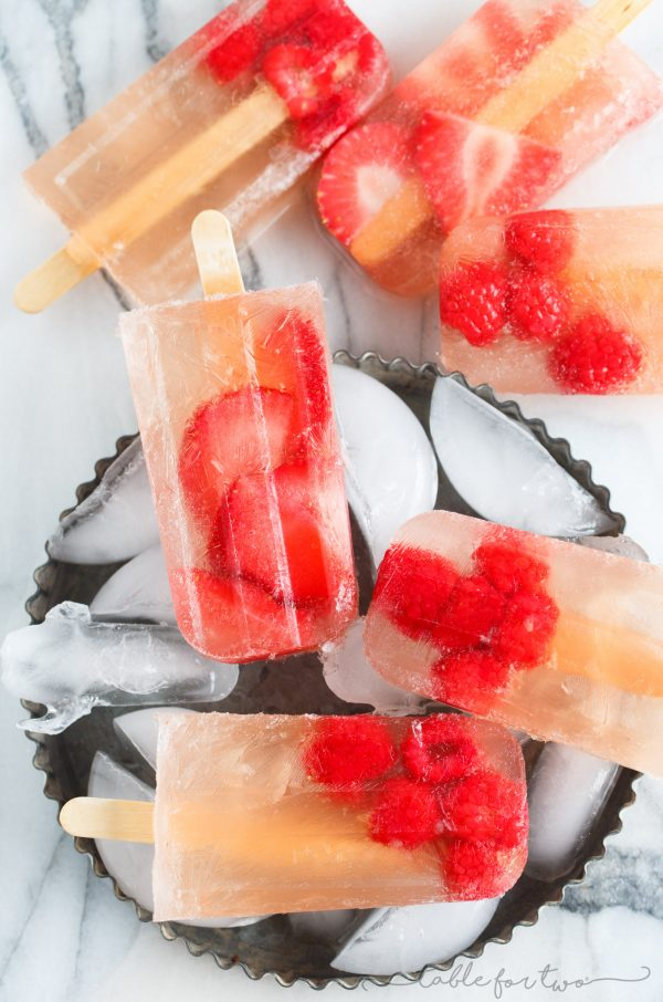 Cool down this summer with a refreshing frozen treat! Rosé fruit pops are the answer to your hot summer day's prayers!