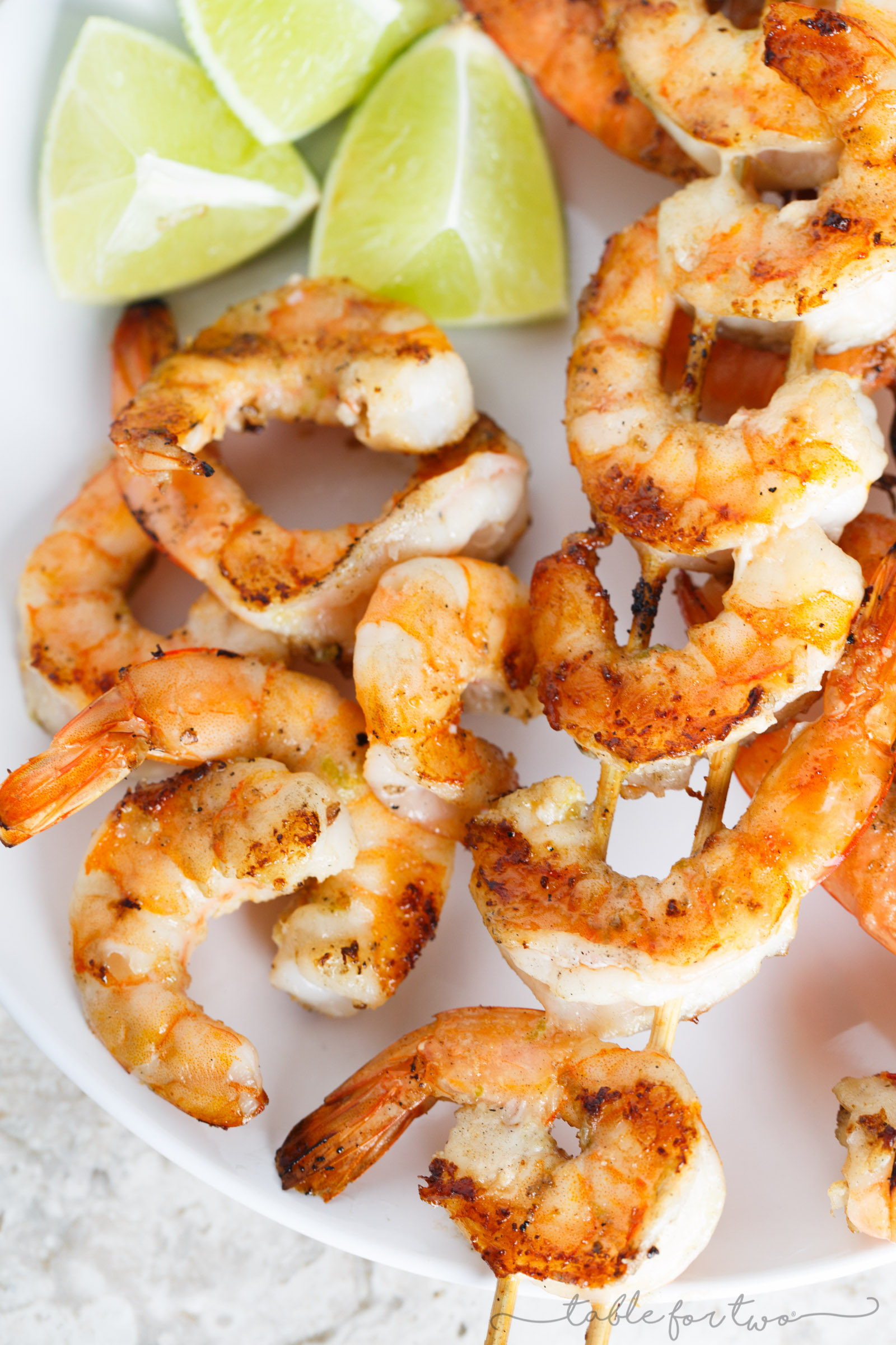 Turn up the grill and make these salted lime butter grilled shrimp skewers for your next cookout! You will love the salty lime and buttery flavor that is slathered all over the shrimp!