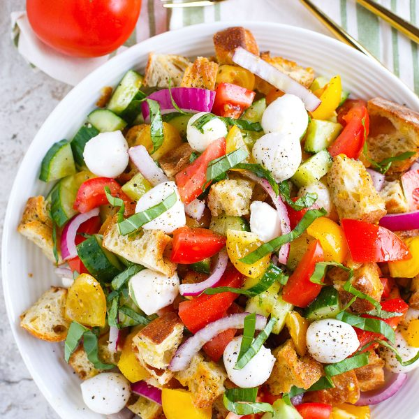 A delightfully light and refreshing summer panzanella salad for your dinner table! This is a great way to use up all the abundant summer produce.