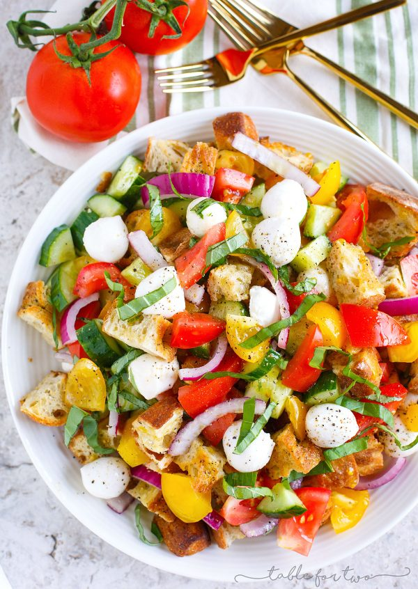 A delightfully light and refreshing summer panzanella salad for your dinner table! This is a great way to use up all the abundant summer produce and a great dinner side item or even as an entree!