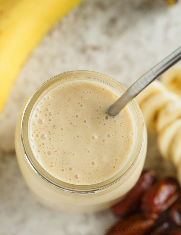 "This banana peanut butter & date smoothie is a healthy alternative to curb your sweet tooth! Sweetened naturally with dates, this smoothie is going to be your new favorite ""dessert!"""