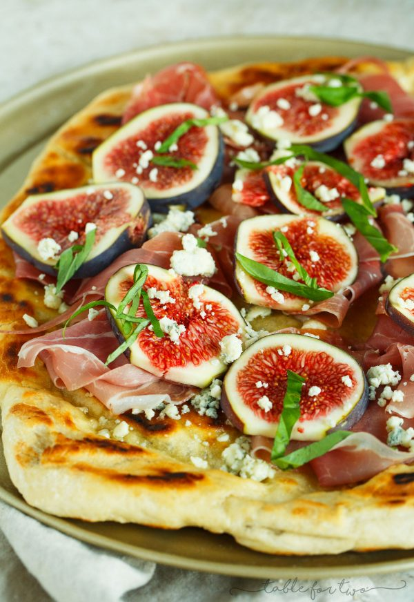 A classic combination of flavors but what better than to throw it on a grilled pizza? The pungent blue cheese pairs so well with the rest of the sweet figs and salty prosciutto!