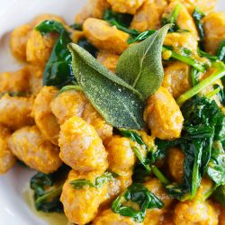 Whole wheat gnocchi with brown butter sage and pumpkin sauce is a deliciously creamy and nutty dish that is full of Fall flavors.