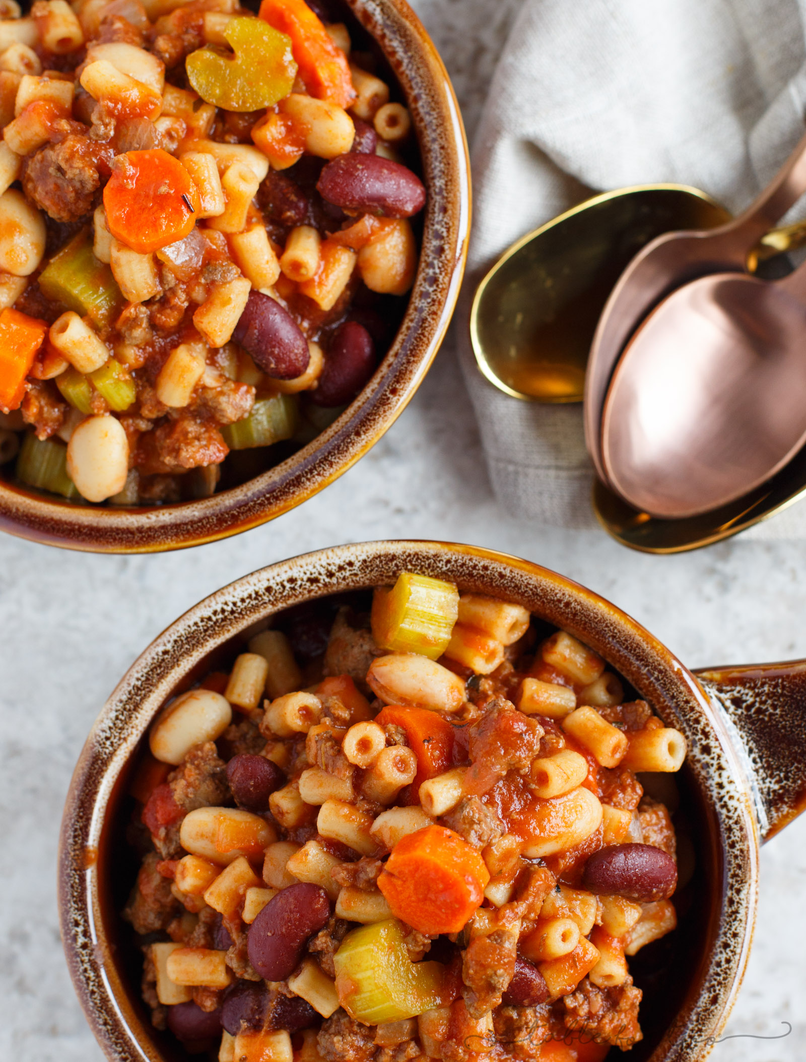 A thick and hearty slow cooker meal. This slow cooker pasta fagioli is full of hearty beef, beans, veggies, and pasta. Makes for great comfort food in the cooler months or for busy weeks that leftovers won't get boring!