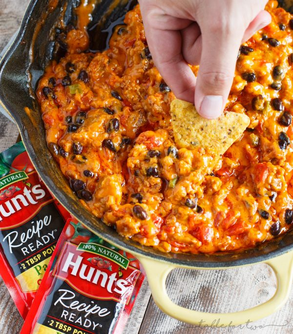 A cheesy dip for all your tailgating and game days! This cheesy chorizo chili dip is so easy to whip up and all your friends will be wanting the recipe! Made with ingredients you probably already have in your pantry; you will love how easy this is to prepare!