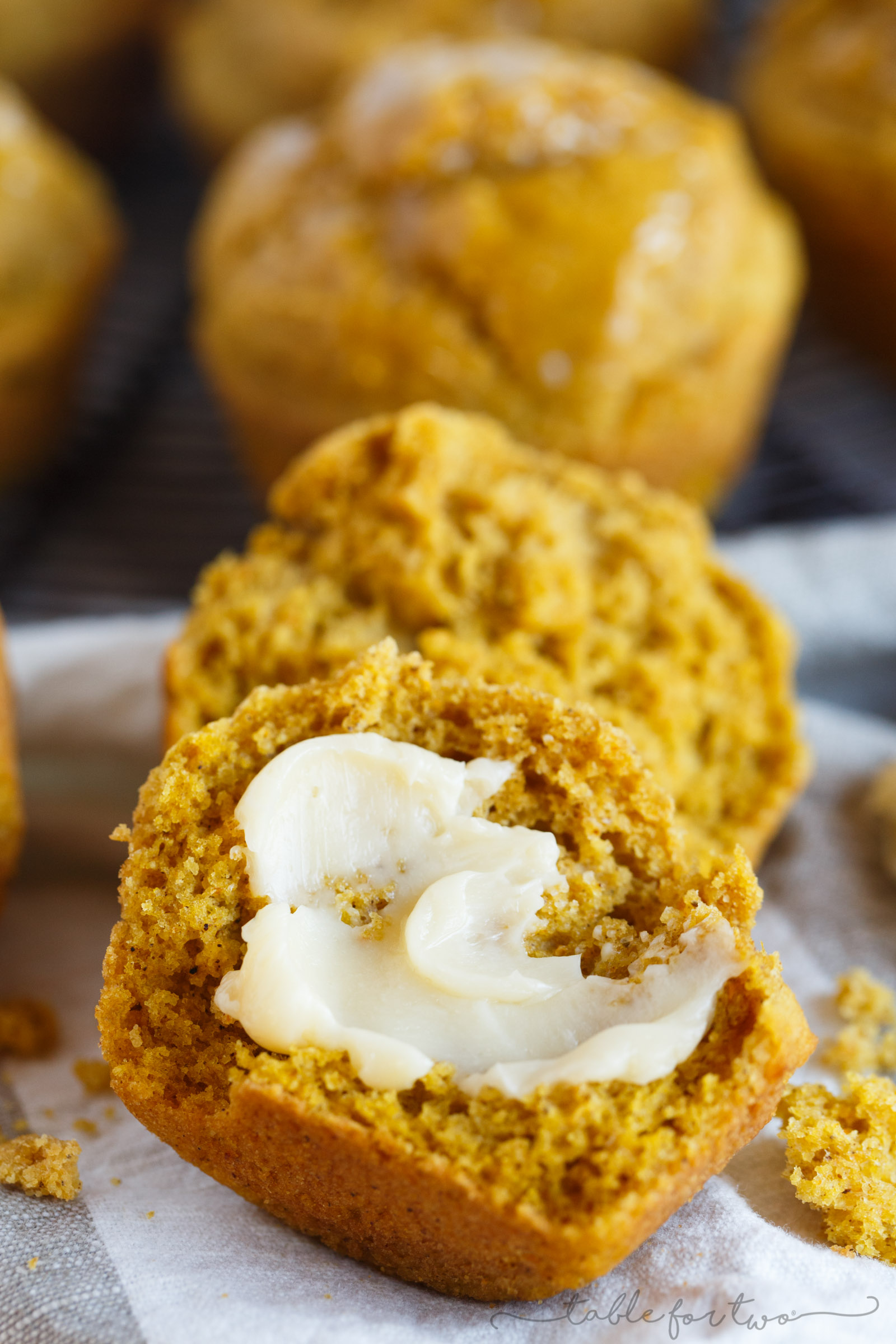 Ditch the dinner rolls and give these pumpkin cornbread muffins a shot! The perfect companion to your dinner table or holiday meal. Warm cornbread muffins slathered in butter are the way to go!