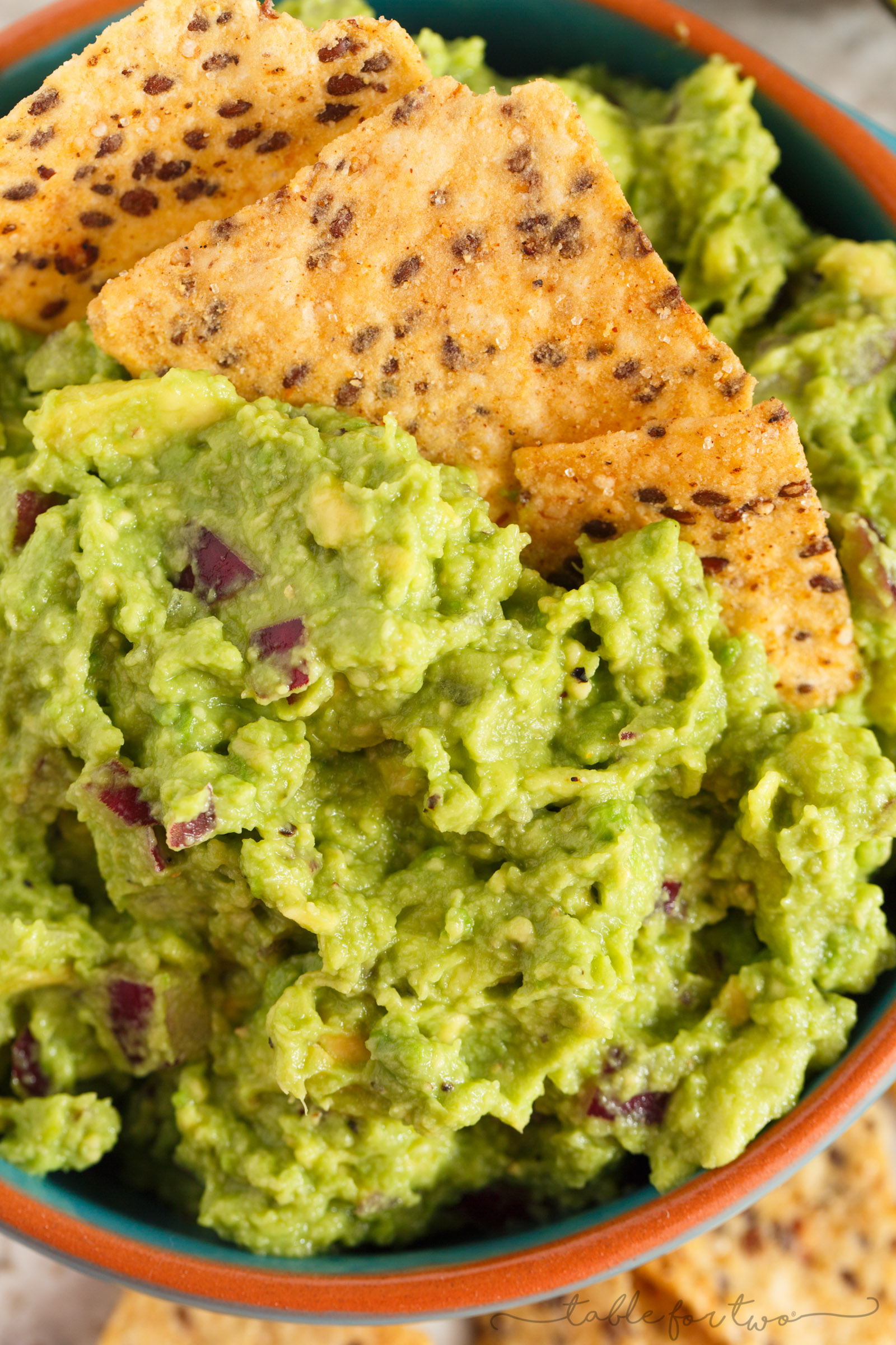 Everyone has to have a great guacamole recipe in their arsenal. Our favorite guacamole recipe is full of creaminess, tang, and bite! You will LOVE this version and always make batches of it to have on hand!