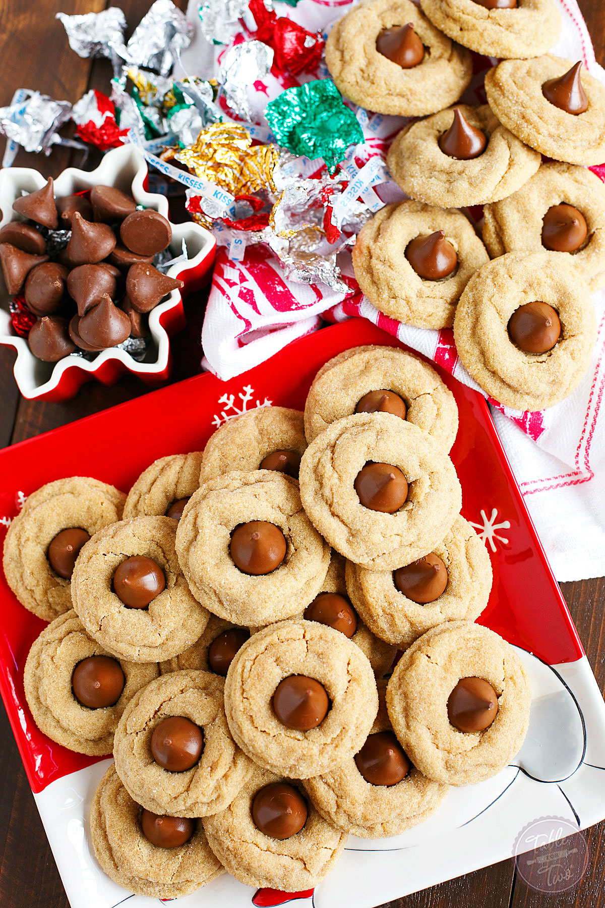 These classic peanut butter blossom cookies are a traditional holiday cookie around Christmas time! Soft and pillowy with a chocolate Hershey kiss in the center! You'll want to make a large batch as they are way too easy to eat and your family won't be able to keep their hands out of the cookie jar!