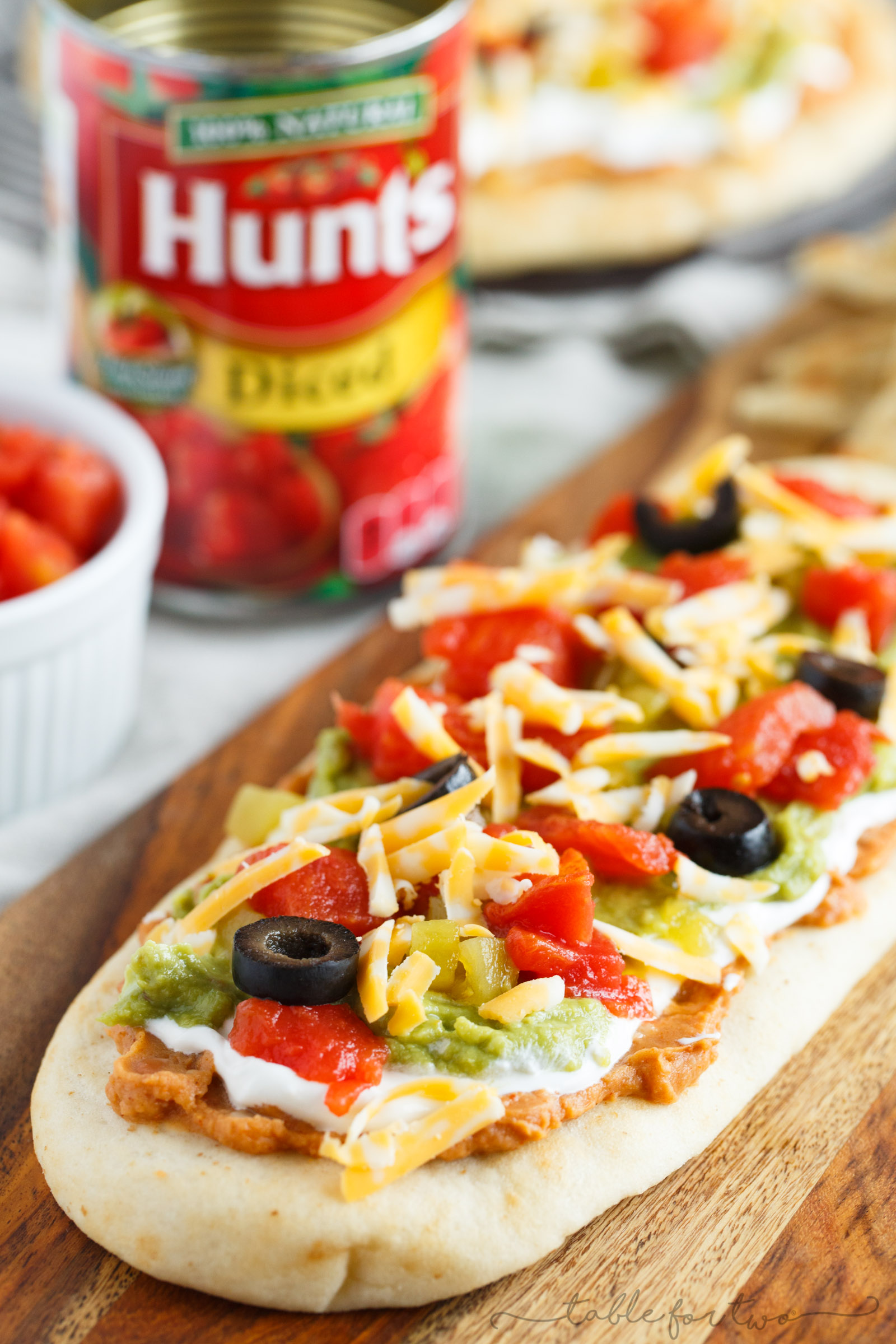 A 7-layer dip but all on a piece of flatbread! A much easier way to get from dip to mouth! #HuntsDifference #ad