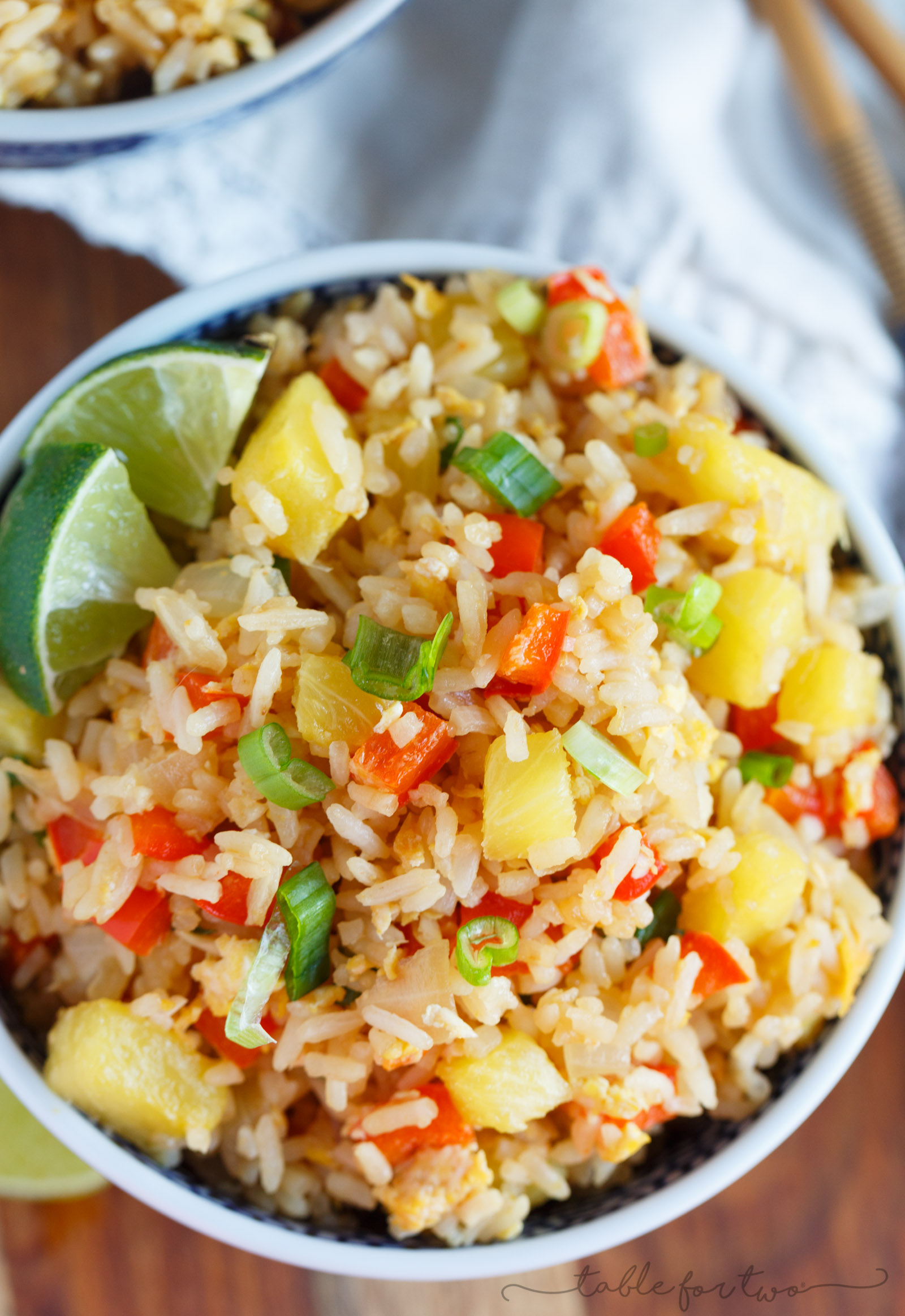 Take-out or take-in? You won't be able to tell that this pineapple fried rice was homemade and just as delicious as calling your neighborhood Thai takeout place! Much healthier to make this pineapple fried rice at home and it's super easy!