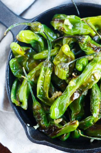Blistered shishito peppers tossed in garlic and olive oil make for a great snack if you're feeling a little heat!