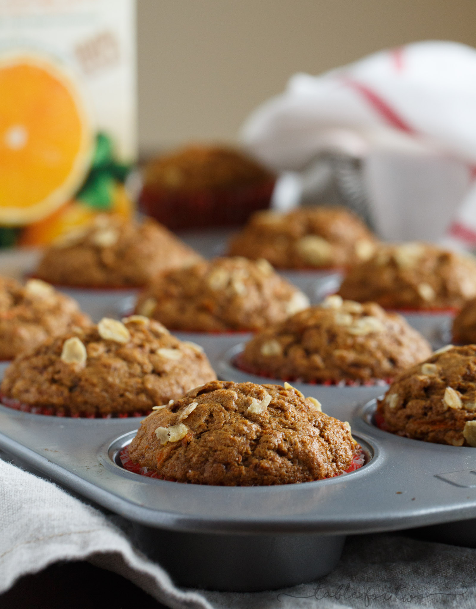 Incredibly flavorful, moist, and fluffy muffins for a quick on-the-go breakfast! Warm spices, orange and carrots make this spiced orange and carrot whole wheat muffin so tender and full of healthy goodness for your mornings!