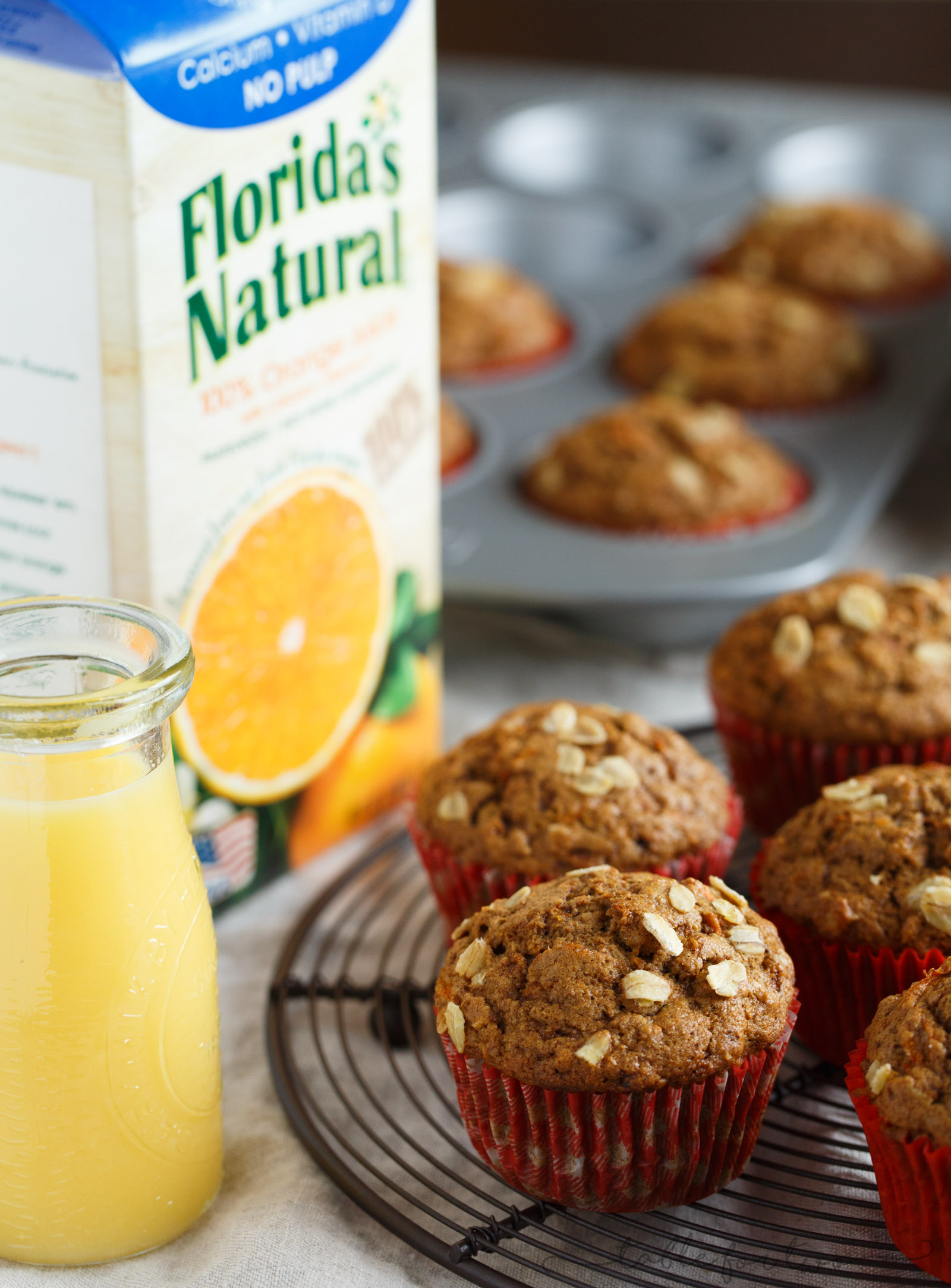Incredibly flavorful, moist, and fluffy muffins for a quick on-the-go breakfast! Warm spices, orange and carrots make this spiced orange and carrot whole wheat muffin so tender and full of healthy goodness for your mornings! In partnership with #FloridasNatural. #ad