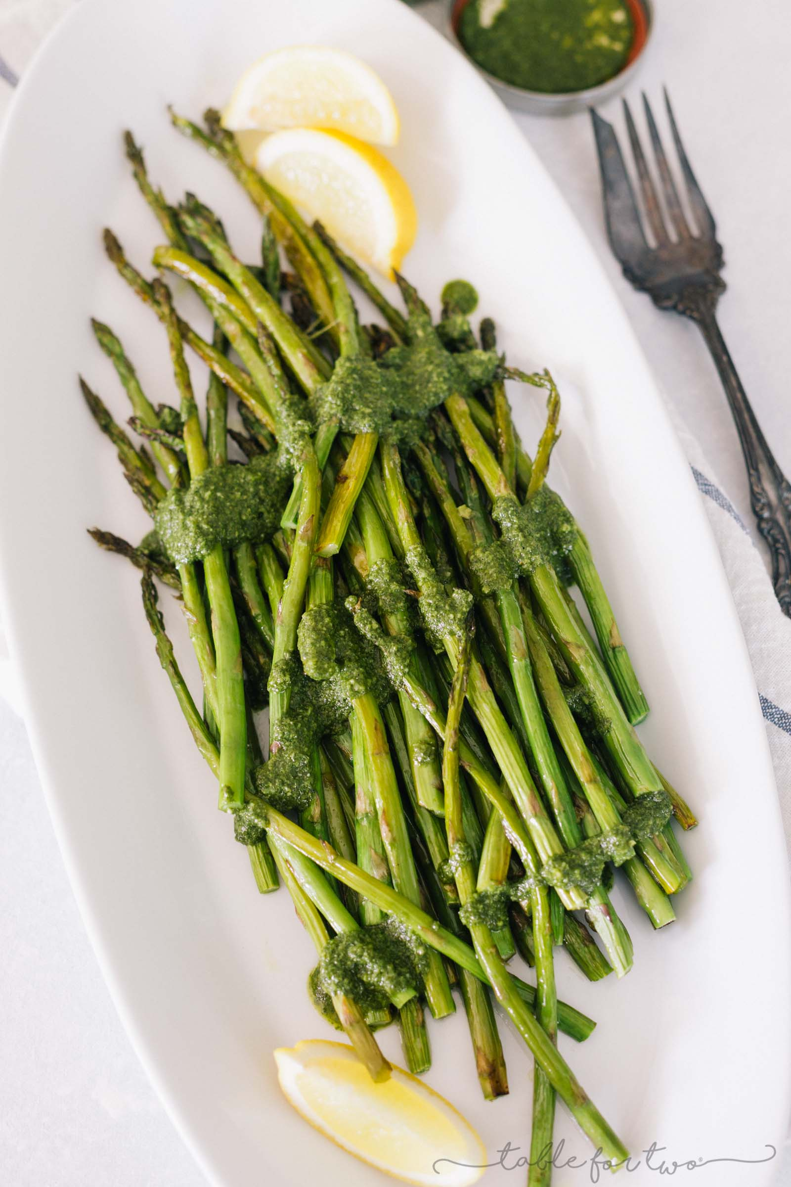 Dress up your asparagus this season with a lemony pesto drizzled all over! This roasted lemony pesto asparagus will be a new favorite side dish!